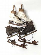 Ice Skating: Two pairs of Ice skates, one a pair