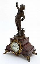 French Clock : a red marble cased mantle clock  wi
