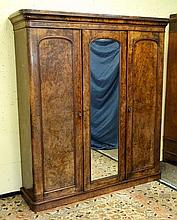 A Victorian triple burr walnut wardrobe with centr