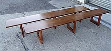A pair of mid century teak benches each with three