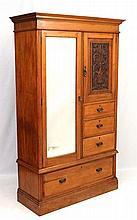 A Victorian blonde walnut compactum style wardrobe