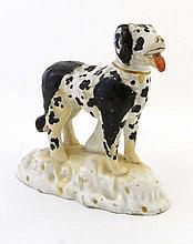 An early 19thC Staffordshire pottery figure of a