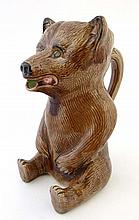 A 19thC majolica novelty jug in the form of a