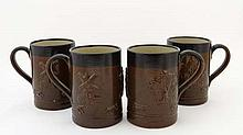 A set of 4 2-tone stoneware tankards decorated