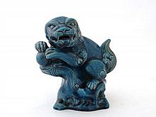 A Oriental turquoise glazed temple dog of fo
