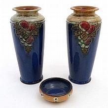 A pair of Royal Doulton Lambeth tall vases, number