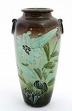 A Moorcroft style twin handled vase decorated with