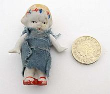 A Small continental miniature bisque doll with joi