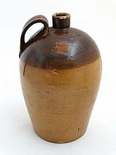 A 19thC staltglazed 2-tone bullet shaped flagon wi