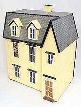 A large mid 20thC three storey wooden dolls house