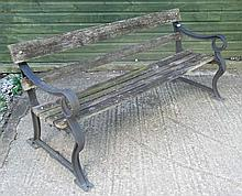 A communal Park style old garden bench with painte