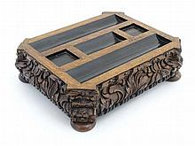 A Victorian inkstand / Standish of carved oak with