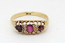 An 18ct gold ring set with central ruby flanked by