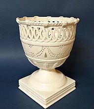 A contemporary Classical Creamware Urn by