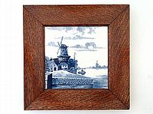 An early 20th Century oak framed blue and white