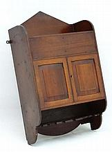 A late 19thC wall hanging smokers cabinet having bowed sect