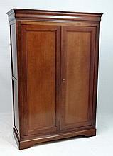 A late 20thC Grange fruit wood 2-door Continental wardrobe