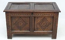 A 17thC oak small coffer with peg joints, twin panelled sec