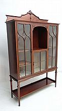 A fine later Victorian glazed front display case with open