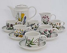 A Portmerion '' Botanic Garden '' Coffee set. To include Coffee pot, 6 cups , 6 saucers and milk jug. Coffee pot 6 1/2'' high. Cups 2 3/4'' high, Saucers 6'' high. (14)