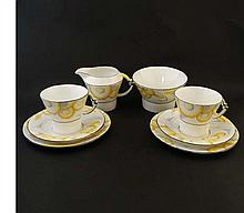A Royal Albert '' Princess Marina '' pattern Art Deco part tea set . Decorated with yellow flowers with grey details on a white ground. To include a cream jug, sugar bowl, 2 cups, 3 saucers and 2 plates. Cup shape, Art Deco. Pattern issued 1927 to