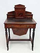 Ladies work table : An inlaid walnut and burr walnut sewing table / bonnheur du jour with gold tooled inverted break front leather top, cupboards and drawers over a single drawer and having sewing well under. 27 1/4