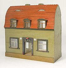 A late 19th / Early 20th C German hand painted wooden dolls house. Made by Mr Bookman in Hannover. Having original Interior papers , glazed windows in wooden frames, open back and wreath for Christmas above the door. Bears label under. 20 1/4'' High.