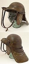 Militaria : English Civil War : A 20thC reproduction ' Lobster Pot ' Zischagge Cavalry Helmet . The one-piece skullcap having three reticulated armour sections to the back , cheek pieces to the sides , the front with pivoting peak visor and attached