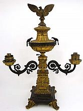 A 19thC pedestal bronze and ormolu 2-branch oil lamp with eagle finial , 2 perched eagles with decorative squared column and standing on a stepped base with acanthus feet. Approx 21 1/4