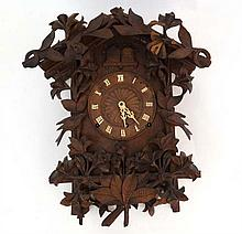 Black Forest 3 train Cuckoo Clock : a ' Camerer , Kuss, Tritschler & Co , 522 Oxford Street ' Swiss / German Black Forest carved Twin Cuckoo Clock with two Cuckoos , flower and foliate carved decoration , Roman Numerals to dial, striking on 2 coiled