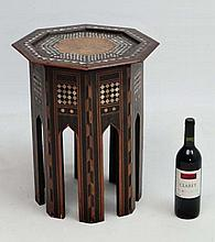 A low octagonal Moorish table with mother of pearl and ebony inlay with shaped leg sections . 15 1/4