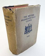 Book: '' The British Pharmaceutical Codex 1934 ''. The Pharmaceutical Press, London. Navy blue bound with gilt lettering and having original dust jacket.
