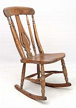 A 19thC elm seated rocking chair with high back and unusual pierced bottle shaped back splat 35 1/2