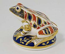 A Royal Crown Derby paperweight formed as a frog in Imari colours. c1986. Bears Red Royal Crown Derby mark to base. 3 1/4'' High