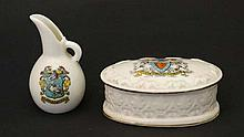 Two items of crestedware to include a small jug bearing Aylesbury crest by Grafton China, with factory stamp to base. 3'' high. Together with a lidded pot having City of Hereford crest by Royal Ivory Porcelain, with factory mark to base. 3 3/4'' long