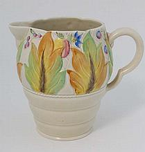 A Clarice Cliff Newport Pottery cream glazed jug the top section decorated with raised leaves and berries in autumnal colours. Factory stamp to base. 7 1/2'' high.