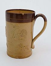 A Royal Doulton Lambeth stoneware mug. Decorated in relief with a hunting scene and figures. Height 5 1/4