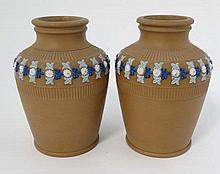 A pair of Royal Doulton silicon ware vases, number 5685. Impressed factory marks to base. 5 3/4'' High.