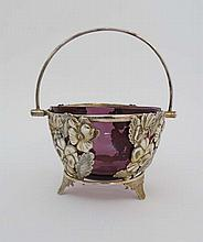 A silver plate basket with floral decoration and swing handle with amethyst glass liner. 4 3/4
