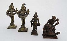 Asian Artifacts : A pair of late 19thC Indian God figures holding Incense trays, an Indian God figure riding a sacred bird together with a copper warring ( fighting) Ceylonese God group (4) the largest 4 3/4 high.