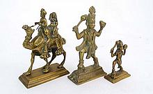 Asian Artefacts : A late 19thC brass Indian figure of a camel, being ridden by an Indian man and  his wife together with two late 19th C figures of the Hindu Monkey God