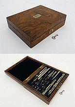 A 19thC burr walnut and brass Army and Navy 2- tier nickel and ivory technical drawing set with key lock. 8