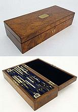 A burr walnut case containing a quantity of nickel drawing instruments etc. The two-tier box marked Hobbs of London and marked to top 'HR Langford May 12th 1890'. 14 1/4