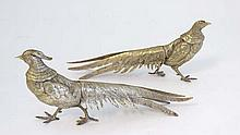 A pair of silver plate menu holders in the form of a pair of Golden / Chinese pheasants. The tallest 5 1/4'' high x 11 3/4'' long.