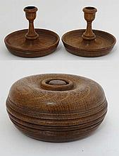 Brighton Bun: An oak circular formed travelling twin candle set , unscrewing to reveal two sconces. 4 7/8'' diameter.