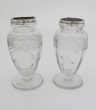 A pair of glass vases of pedestal form with floral and foli