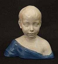 An Italian Majolica style bust of a boy in the manner of Ca