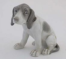 A late 19thh / early 20thC Gebruder Heubach hound figurine,