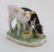 A USSR figure group of two calves drinking milk from bucket