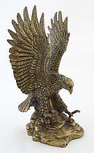 A 20thC cast brass figure of an eagle 10 1/4